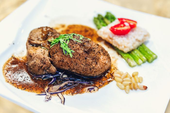 Vegnan Hericium Mushroom steak of black truffle sauce with asparagus