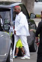 Kanye West Kim Kardashian Kourtney Kardashian and Khloe Kardashian leave his Sunday Service