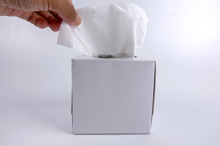Cropped Hand Holding Facial Tissue On White Background