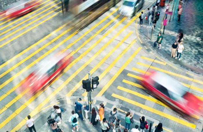Blurred cars driving on city crosswalk