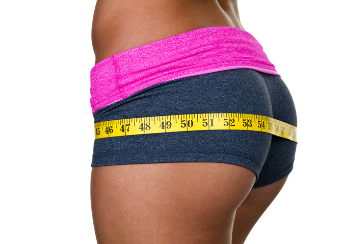 Female buttocks wearing workout clothing