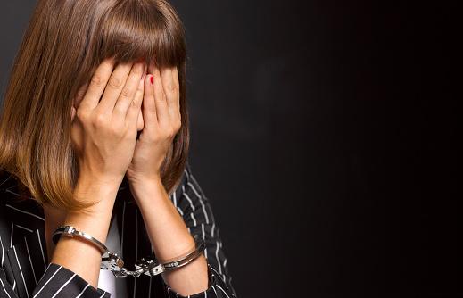 Arrested woman woman feeling guilty