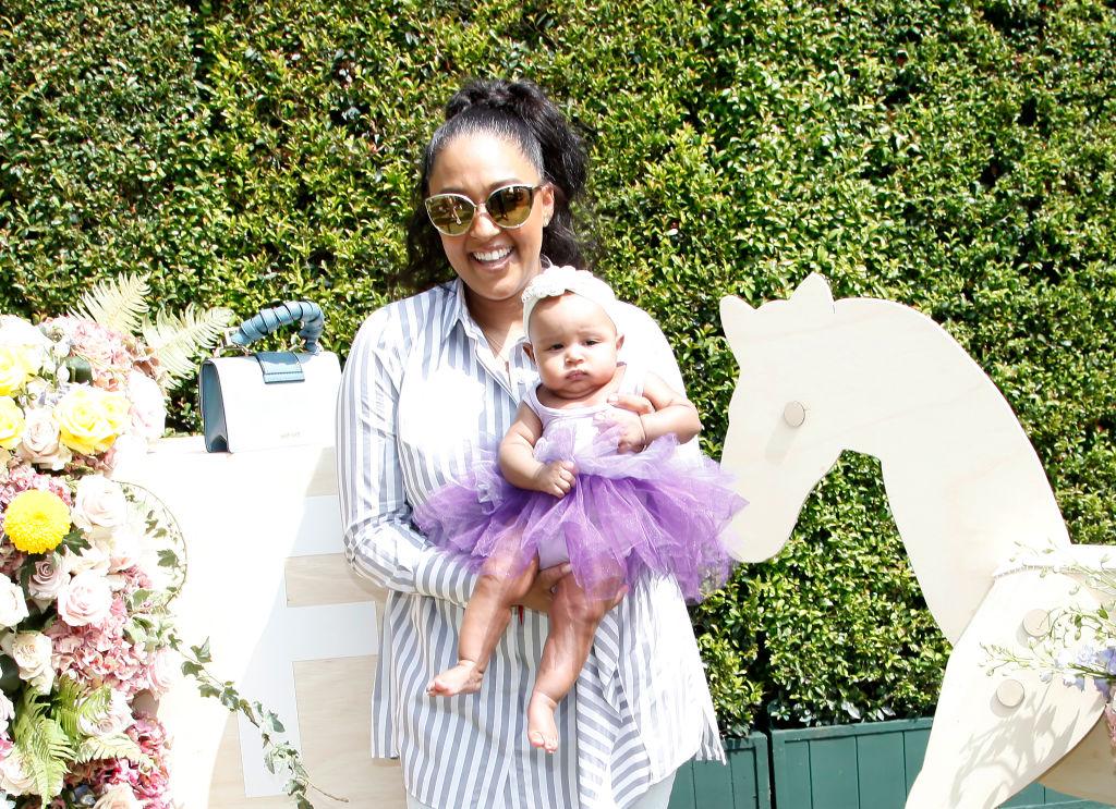 Tia Mowry Hardrict and daughter Cairo