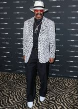 Dennis Graham at The Fashion Nova x Cardi B Collection Launch Event