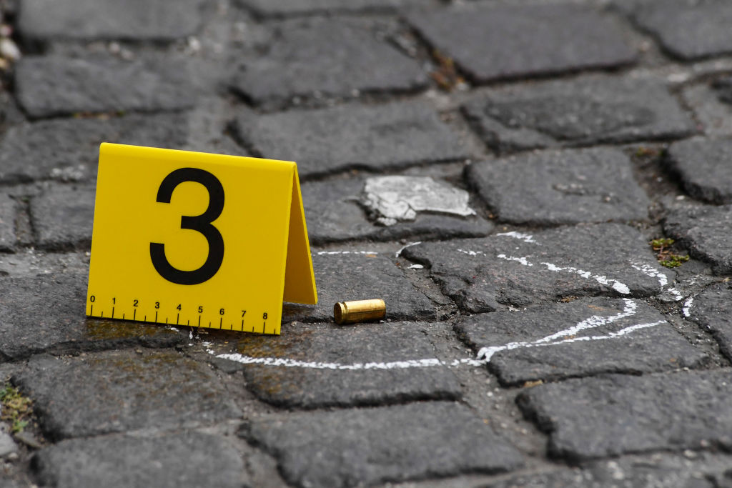 Bullet markers placed by forensic policemen at the crime...