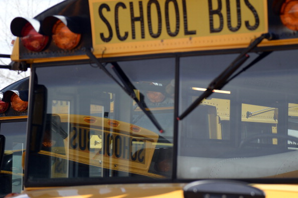 Drivers get their buses ready at the bus terminal