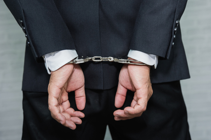Midsection Rear View Of Businessman With Handcuffs