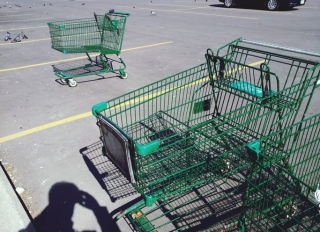 High Angle View Of Shopping Cart On Parking Lot