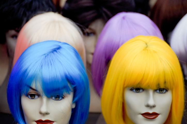 Close-Up Of Multi Colored Wigs On Mannequins At Shop