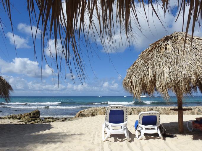Deck Chairs At Beach Against Sky