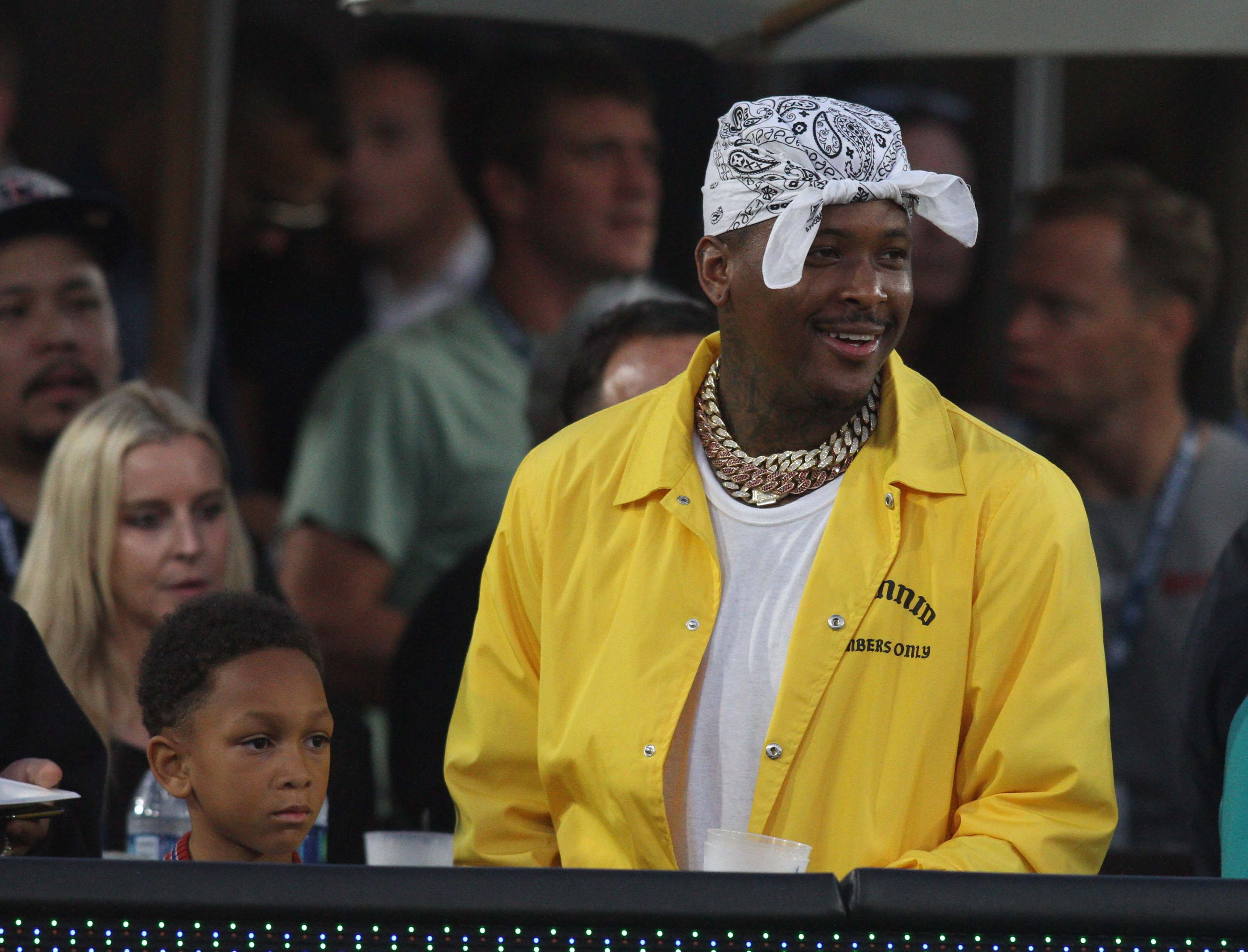 YG watches the Rams play
