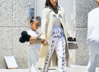 Kim Kardashian and North West Kourtney Kardashian and Reign Disick
