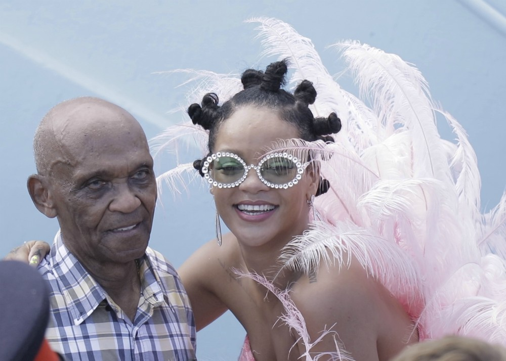 Rihanna wears pink feathered costume to Cropover