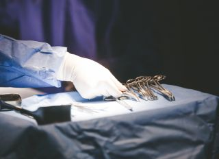 Midsection Of Doctor Working At Operating Room