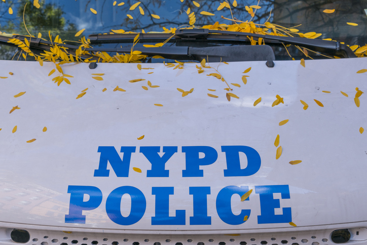 Autumn color fallen leaves on the Police car at New York NY USA on Nov. 13 2018.