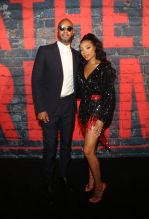 Swizz Beatz and Lil Mama at the Godfather Of Harlem Screening at the Apollo