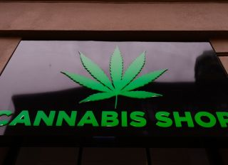 A Dr Ziolko Cannabis Shop sign is seen at the city centre...