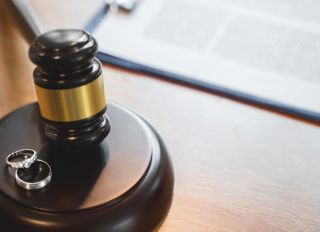 High Angle View Of Rings On Gavel At Table