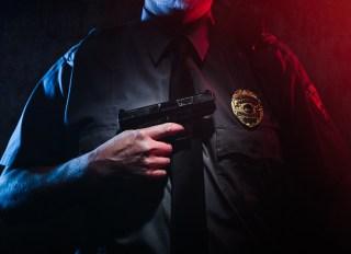 Police Officer Holding Gun