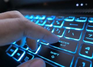 hacker hand typing on keyboard