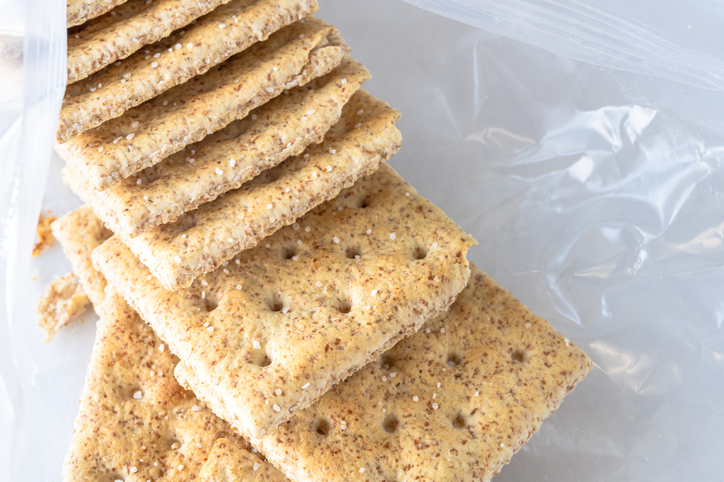 A group of whole wheat soda crackers in an open package