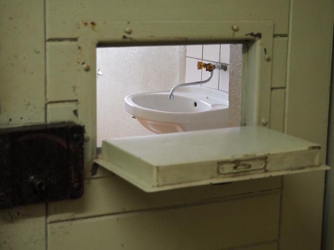Sink Seen Through Open Window At Prison