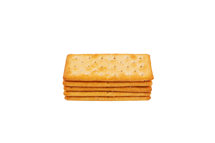 Stack of Delicious salty crackers isolated on white background