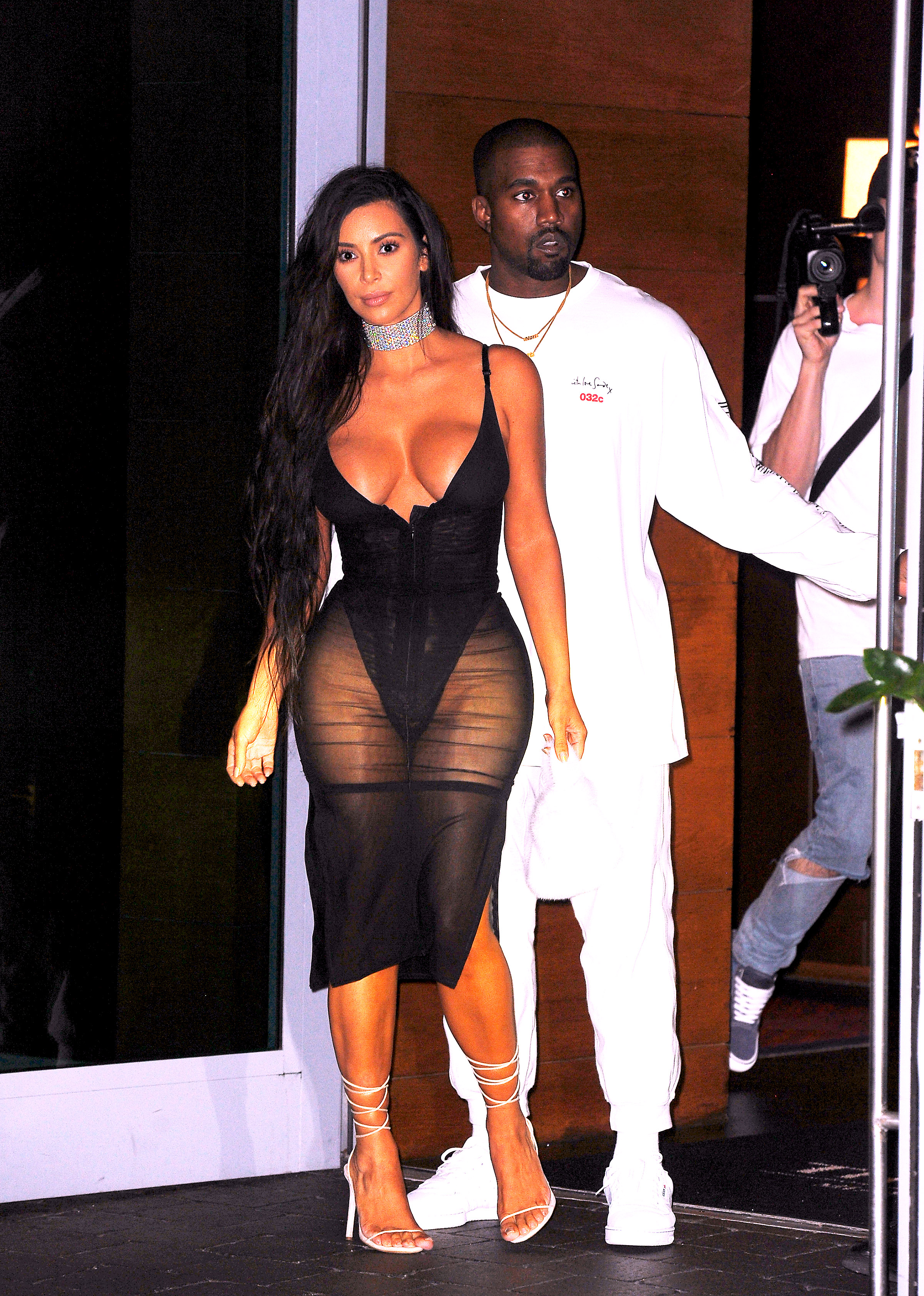 Kim Kardashian West wearing lingerie look and Kanye West in Miami