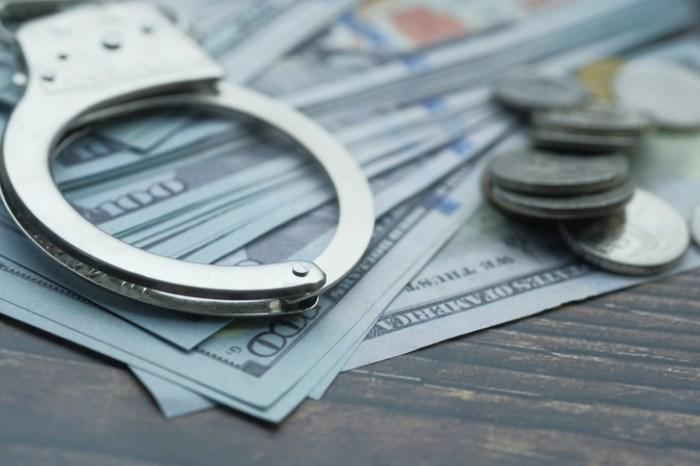 handcuff and cash