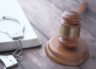 gavel and a book with handcuff