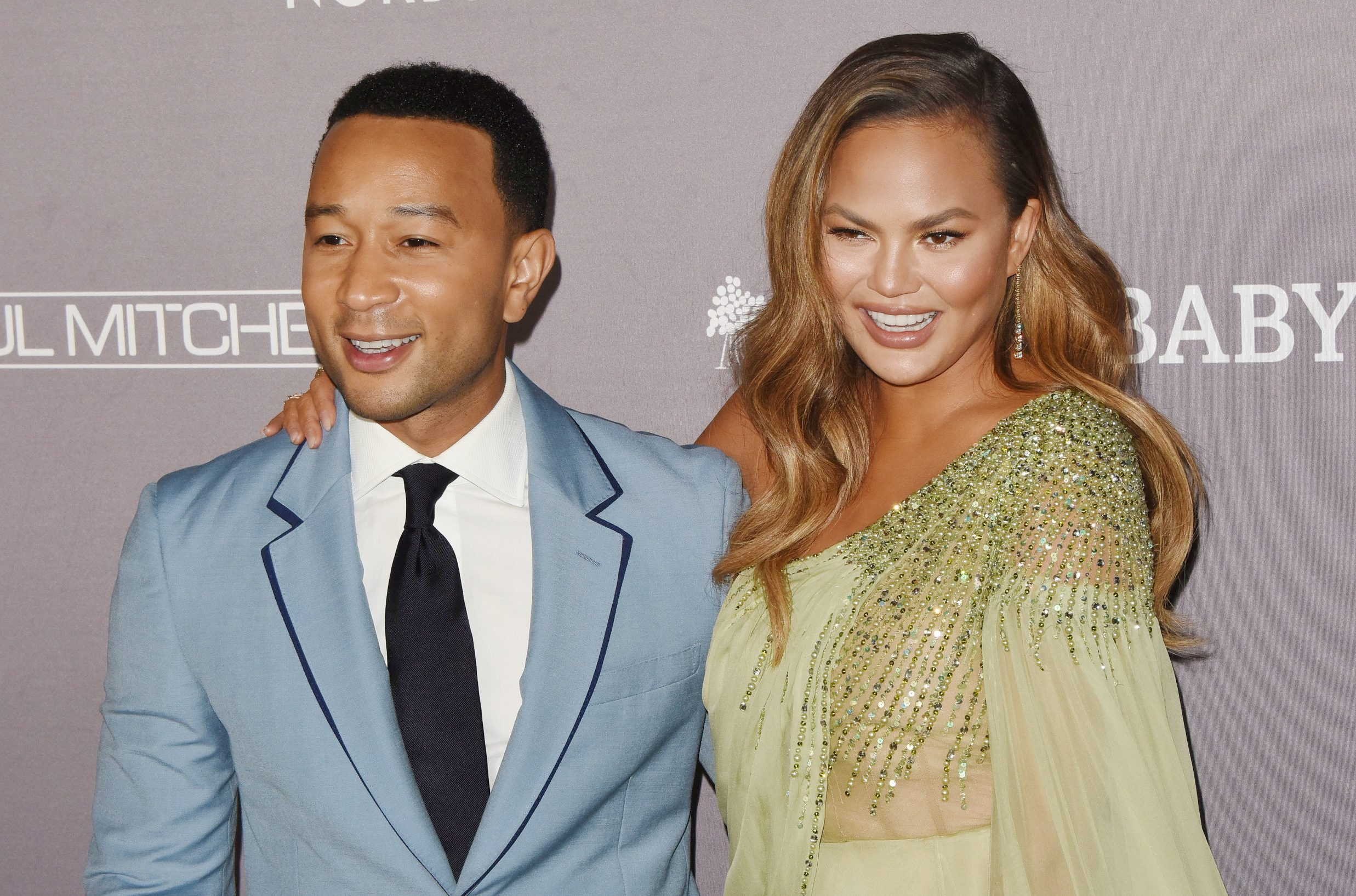 Chrissy Teigen, John Legend attends the 2019 Baby2Baby Gala Presented By Paul Mitchell at 3LABS on November 09, 2019 in Culver City, California\n© Jill Johnson/jpistudios.com