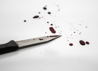 Close-Up Of Knife With Blood On White Background