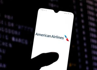 In this photo illustration the American Airlines logo is...