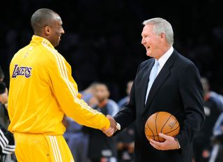 LO SANGELES, CALIFORNIA FEBRUARY 3, 2010–Lakers Kobe Bryant shakes hands with Jerry West during a c