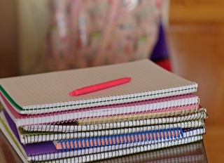 Stacks of notebooks on table