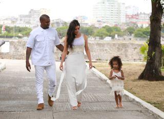 Kim Kardashian West, Kanye West and North West wear all white