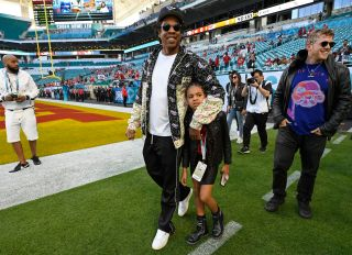Jay-Z & Blue Ivy on the field at Super Bowl Liv