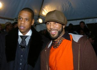 Jay-Z (left) and rapper Common arrive at the Ziegfeld Theatr