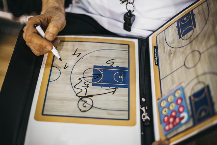 Close-up of senior basketball coach making a strategy