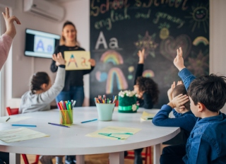 Preschool kids learning letters