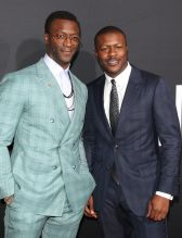 Aldis and Edwin Hodge at The Invisible Man Premiere