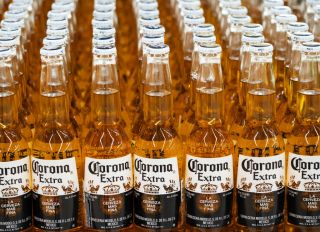 Bottles of Corona beer on a shelf in a store...