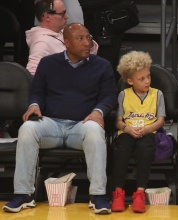 Byron Allen and son Lucas Allen at the Lakers game