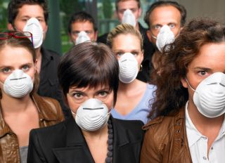 Group of people wearing protection masks - stock photo