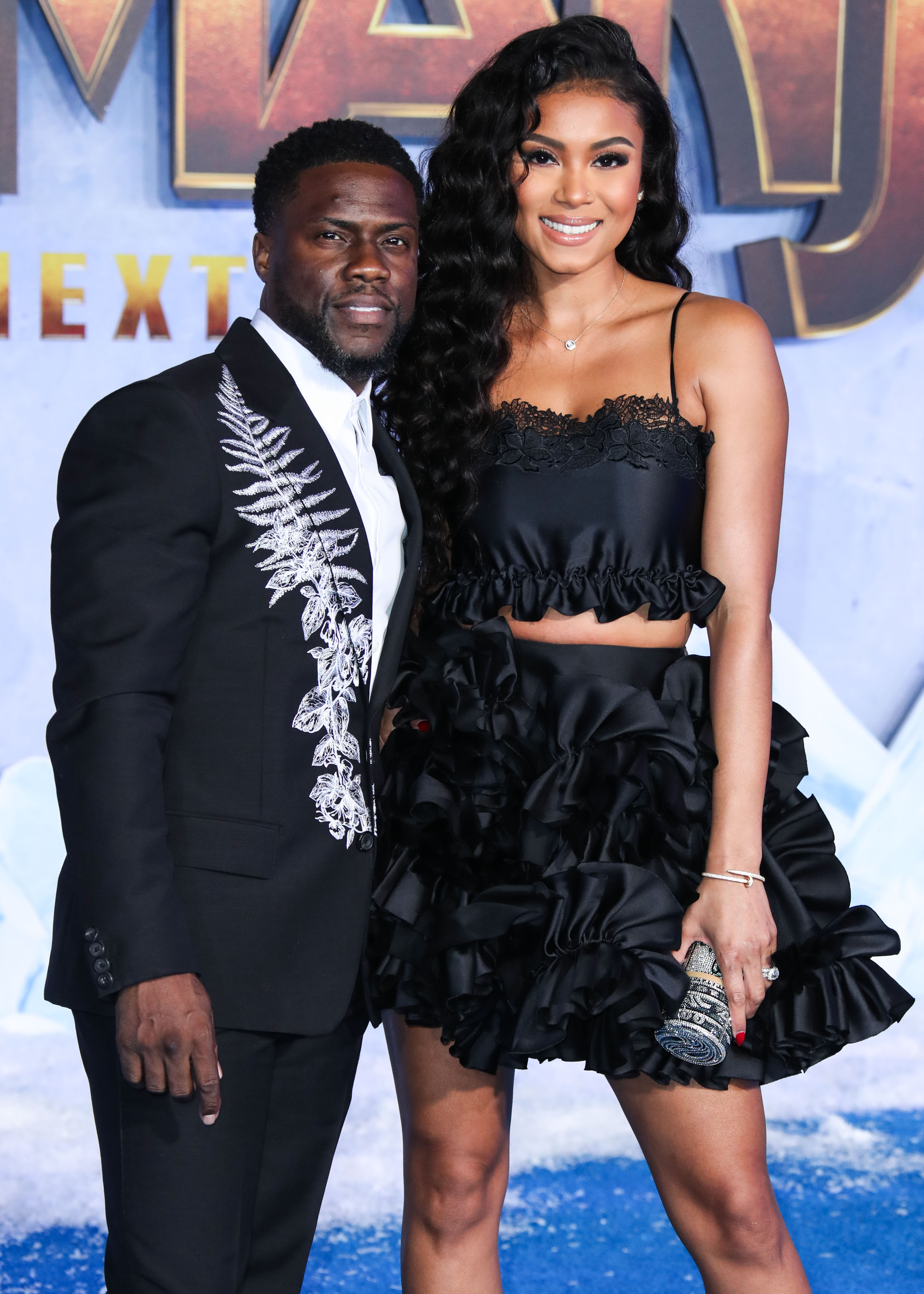 Kevin Hart and Eniko Hart at his premiere for Jumanji