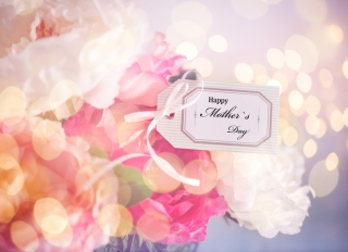 Mother`s Day Greeting Card on a Flower Arrangement