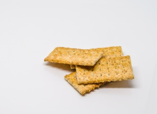 Close-Up Of Snack Crackers Against White Background