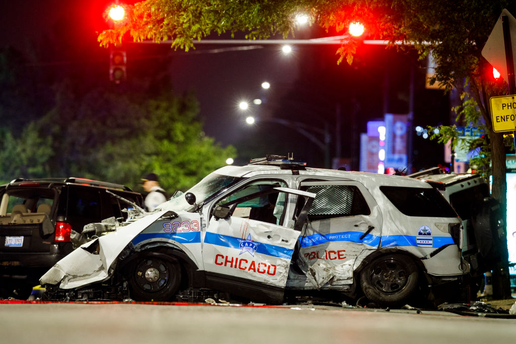 Chicago police car crashes into SUV, killing driver, while chasing suspect wanted for homicide and several shootings