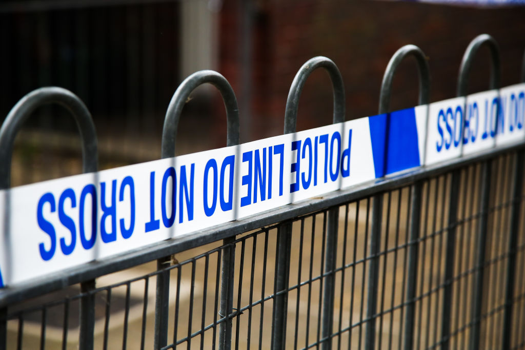 Police tape on a fence at a crime scene cordon in London...