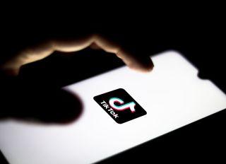 In this photo illustration the TikTok logo seen displayed on...